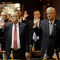 Legislators are sworn in to office in the House of Representatives